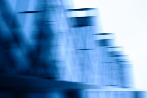 Blue business buildings motion blur background