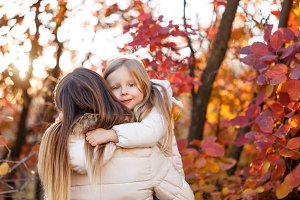 Cute family hug. Autumn