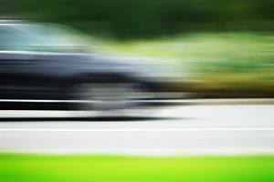 Horizontal car on road motion blur background