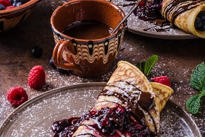 Delicious crepes with forest fruit