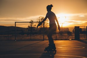 Girl skating at sunset