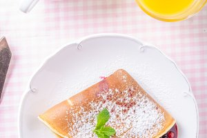 Homemade crepes with berries