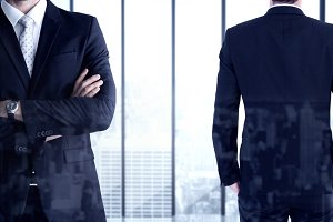 Composite image of rear view of handsome businessman