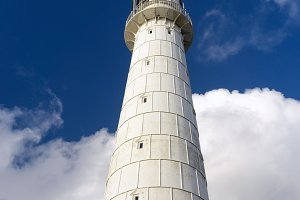 Old lighthouse on the background of the sky