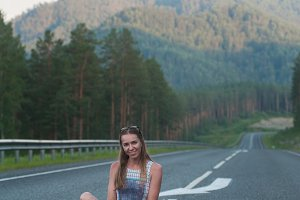 Woman sitting on the road