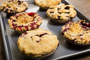 Warm fruit pies on baking pan