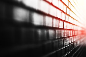 Diagonal brick wall with light leak background