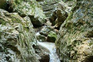 Mountain stream among stones