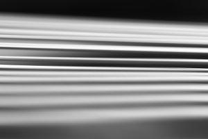 Diagonal black and white files motion blur background