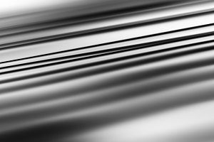 Diagonal black and white files motion blur background