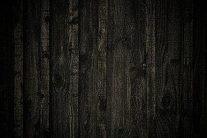 Dark pine wood fence.