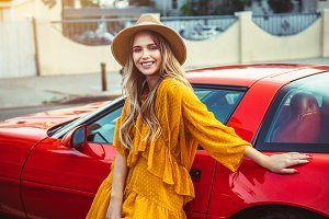 Beautiful woman with red sport car