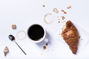 Black coffee with fresh croissant