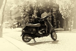 Sepia moped bike on Trondheim streets background