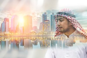 double exposure of Arab man and city