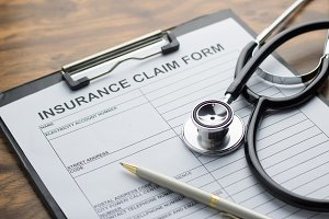 stethoscope and insurance claim form