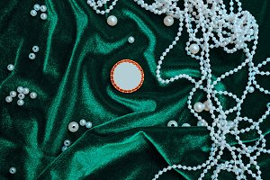 Pearls on fabric background