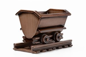 Wooden trolley toy with rails.
