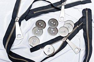 Zipper, buttons, sewing, crafts.