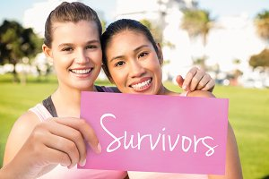 Survivors against two smiling women wearing pink for breast cancer