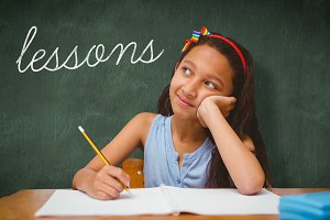 Lessons against green chalkboard