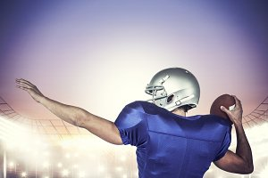 Composite image of rear view of american football player throwing ball
