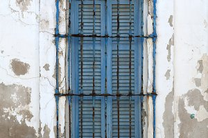 old blue window and old white wall
