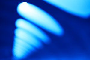 Diagonal blue office lamps bokeh background