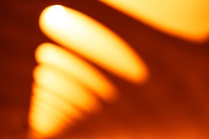 Diagonal orange office lamps bokeh background