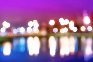 Night city lights bokeh with reflections background