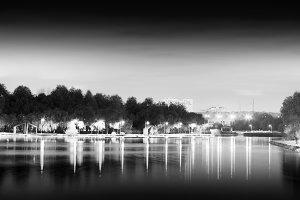 Dramatic night park illumination reflections background