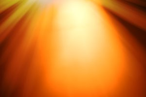 Top orange ray of light bokeh background