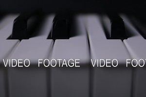 Piano keys on a dark background in motion