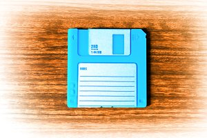 Vintage cyan floppy disc illustration