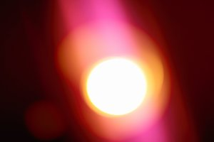 Glowing sun with pink light background
