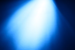 Top blue ray of light bokeh background