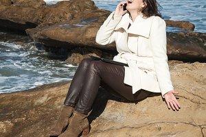 Attractive woman posing at the seasi