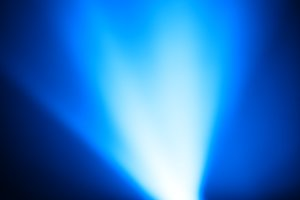 Diagonal blue light leak bokeh background