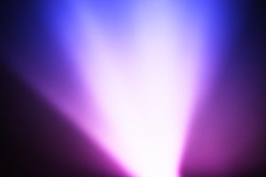 Diagonal pink and purple light leak bokeh background