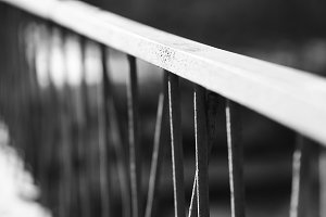 Diagonal black and white banister bokeh background