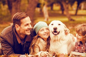Smiling young family with dog