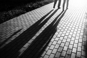 Black and white walking couple in sunset park bokeh backdrop