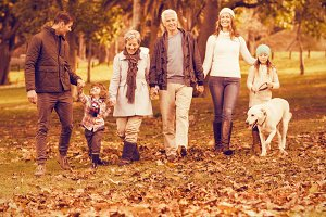 Smiling extended family walking together