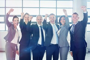 Businessman cheering with clenched fist