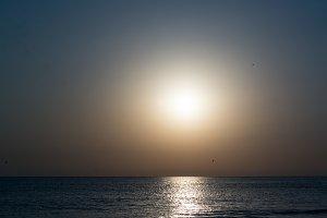 Phantasmagoric golden sunset on the sea