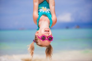 Adorable happy little girl outdoors during summer vacation have fun with her young father