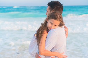 Family on white tropical beach. Father and little kid on the seashore enjoy time together