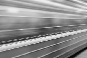 Diagonal black and white motion blur metro train background