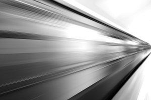 Diagonal black and white motion blur metro train background
