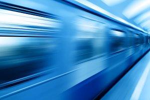 Diagonal blue motion blur metro train background